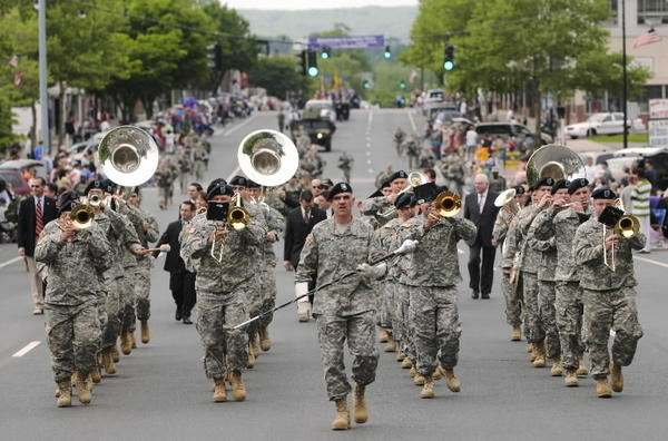 Sgt. 1st class and drum major Rob Breen (center) leads the 102nd Connecticut National Guard U.S. Army Band up Main Street during the town's 2009 Memorial Day Parade.