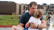 MOORE, Okla. (AP) — A band of thunderstorms battered the Oklahoma City area Thursday, slowing cleanup operations in the suburb where a tornado killed 24 people and destroyed thousands of homes this week.