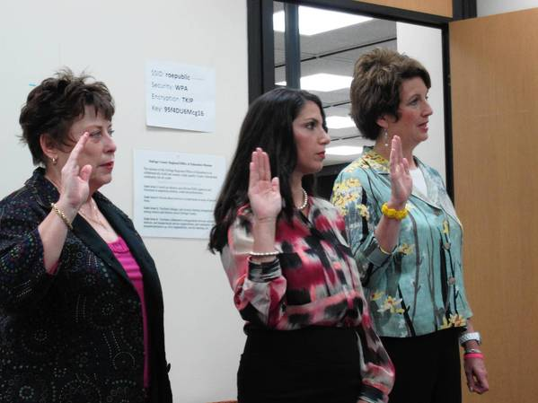 Paula Bowling (from left), Danielle Dittus and Mary Ellen Young are sworn in for the DuPage County Regional Board of School Trustees on May 20.