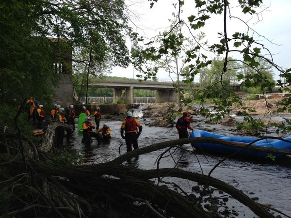 Members of Connecticut Task Force One, which does search and rescue operations, get ready to start training on the Farmington River just below the Collinsville Dam on May 22.