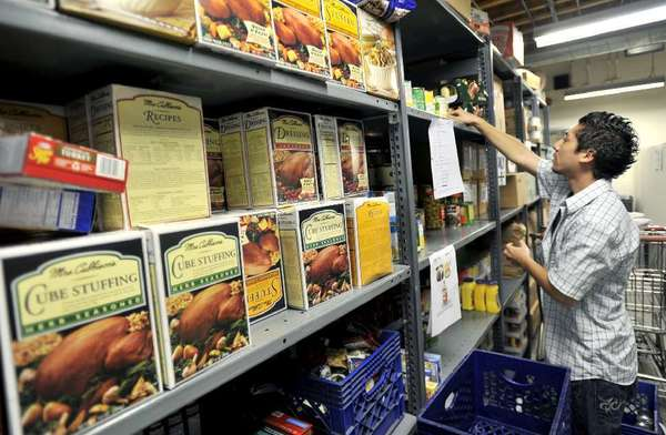 A worker stocks shelves at Burbank Temporary Aid Center, which like other nonprofits this year, received only a fraction of the CDBG funding it requested.