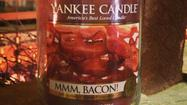 "Yes, you read that headline right. There is a new ""Mmm, Bacon"" candle promoted by Yankee Candle in its ""Man Candle"" series."