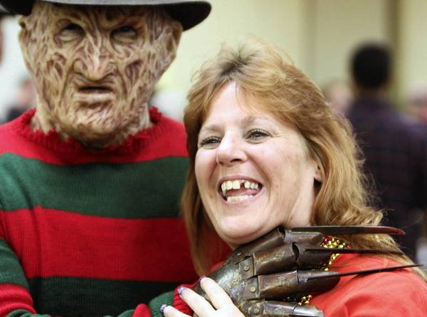 "Kelly Arnold, of Beverly Hills, Fla. poses with ""Freddy Krueger"" from the A Nightmare on Elm Street movies during the Spooky Empire horror convention in Orlando, Fla. Saturday, May 26, 2012."