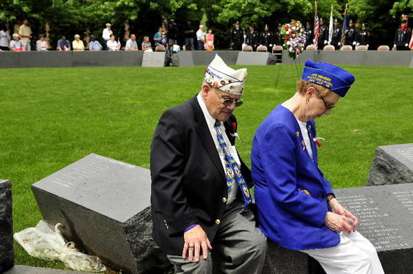 Elliott and Elissa Donn take a moment to reflect as names of fallen veterans are read during a memorial ceremony after the West Hartford Memorial Day Parade in 2011. Elliott served in the Navy from 1959-1961.