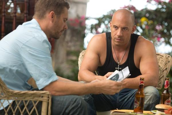 "Paul Walker, left, stars with Vin Diesel in ""Fast & Furious 6,"" which is expected to be the No. 1 film at the box office this weekend."
