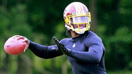 Robert Griffin III dropped back and launched passes during the Washington Redskins' non-contact practice Thursday, the latest sign of progress from the second-year phenom who said his goals include being ready for training camp and starting the season opener.
