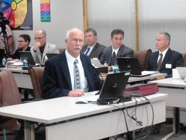 Naperville Unit Education Association President Mark Bailey praises a new three-year teacher contract.