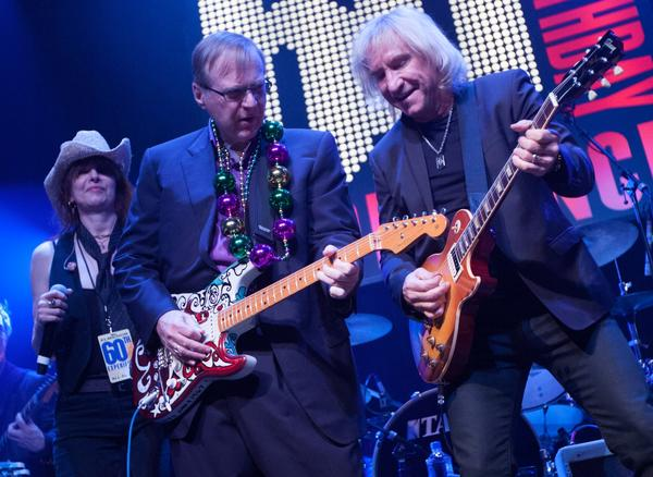 Paul Allen, center, jams with Pretenders singer Chrissie Hynde and rocker Joe Walsh.