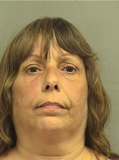 Mary Rose Dutra, 51, of Boynton Beach, is accused of pushing down a woman during an argument, causing the woman to fall and cut her head on Thursday.