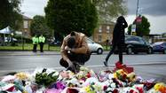 LONDON — British authorities on Thursday began combing through their intelligence files and evidence from the attack site to determine whether the apparently terrorism-related killing of a young soldier on a London street could have been prevented.