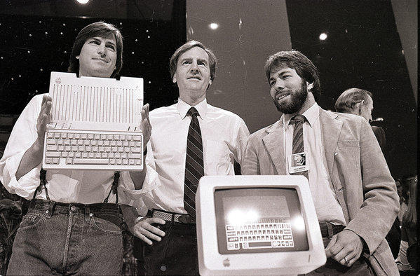 Steve Jobs, left, chairman of Apple; John Sculley, president and chief executive; and Steve Wozniak, co-founder of Apple, unveil the Apple IIc computer in 1984. The Apple II was a mass-produced success that improved upon the now rare and more valuable Apple I.