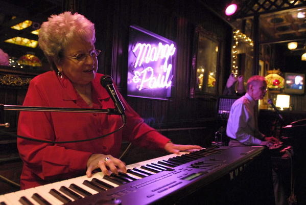 South Bend Tribune File Photo/GENE KAISER Marge Dudeck and partner Paul Jones perform at the Round Oak Restaurant in Dowagiac in this 2006 Tribune file photo. Health problems suffered several months ago by business owner Doug McKay forced him to shut down the restaurant and put an end to the more than 20 years Dudeck and Jones entertained at the establishment.