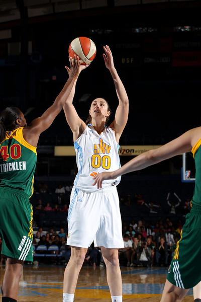 Ruth Riley of the Chicago Sky shoots against Shekinna Stricklen of the Seattle Storm during a game last June.