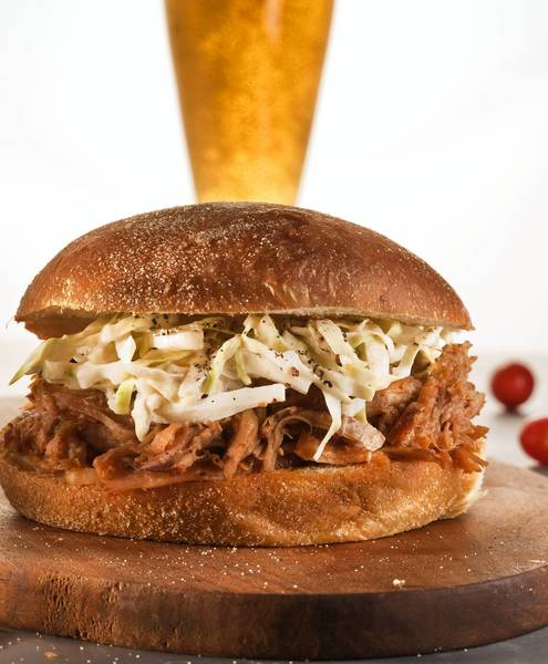 """Pulled pork, whether served topped with slaw on a bun or on white bread, is a satisfying dish that's best cooked """"low and slow."""""""