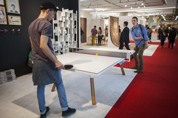 "Students try out the You & Me table designed by <a href=""http://apo.pw/"">Antoni Palleja Office</a> during the International Contemporary Furniture Fair, the most important U.S. show for modern home design, held at Javits Center in New York."
