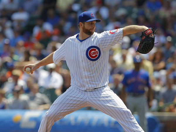 Cubs starting pitcher Scott Feldman delivers a pitch during the first inning against the Mets at Wrigley Field.