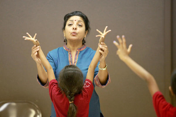 Director Ramya Harishankar, top center, teaches Bharatanatyam, a traditional southern Indian dance style, to a class of girls, ages 5 and 6, at Ektaa Center in Irvine on Tuesday.