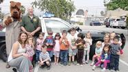Toddlers at La Cañada Flintridge Community Center Preschool learned how to stop, drop and roll when local firefighters and sheriff's deputies recently visited the school.