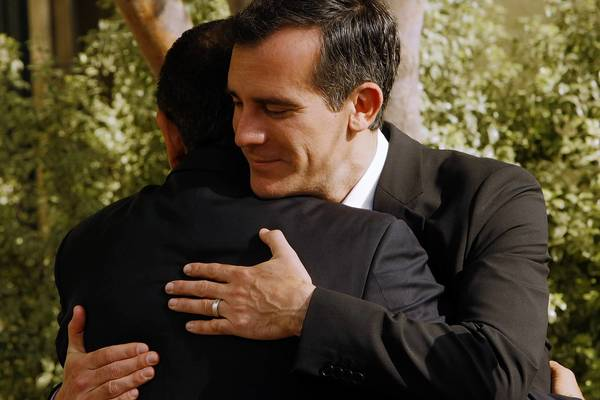 Mayor Antonio Villaraigosa, left, and Mayor-elect Eric Garcetti embrace after a meeting to discuss the transition of office.