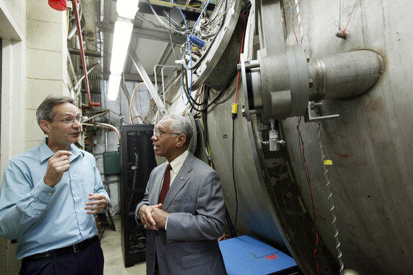 NASA Administrator Charles Bolden, right, talks with electric propulsion engineer John Brophy during a visit to NASA's Jet Propulsion Laboratory.