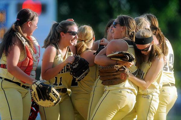 Bethlehem Catholic's girls softball team begins to celebrate their 4-0 victory over Emmaus High School at Patriots Park in Allentown Thursday.