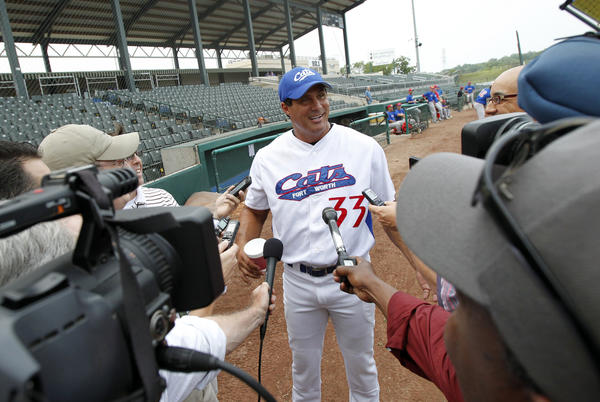 Fort Worth Cats designated hitter Jose Canseco talks to the media before the game against the Edinburg Roadrunners.