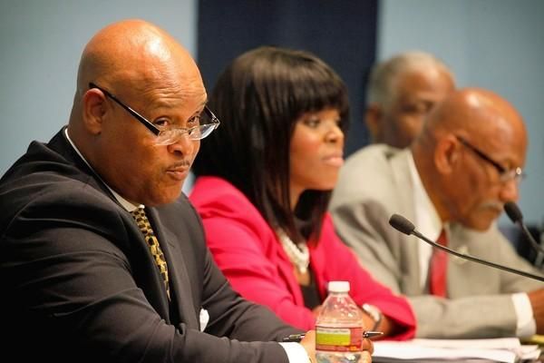 Former Compton Mayor Omar Bradley, left, speaks at a mayoral candidates forum. He is in the running for another term.