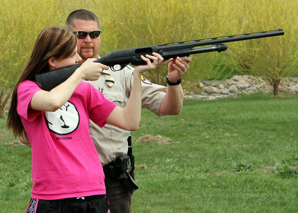 Conservation Officer Dean Schultz gives shotgun shooting pointers to his 16-year-old daughter Ashley, who will be attending the Women on Target shooting event near Sisseton on June 1.
