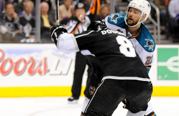 Drew Doughty (8) keeps Sharks T.J. Galiardi away from the puck in the 2nd period in Game 5.