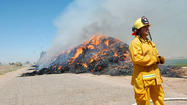 A haystack fire is expected to continue to burn for the next couple of days after catching fire on Thursday morning.