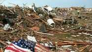 MOORE, Okla. (AP) — After living nearly 20 years in their one-story brick home, Sherry and Larry Wells finally won the lottery — for a state rebate on a home storm shelter, that is. A contractor finished installing the concrete bunker beneath the slab of their garage in early May. About three weeks later, the shelter saved their lives when a tornado that killed 24 people tore through their neighborhood.