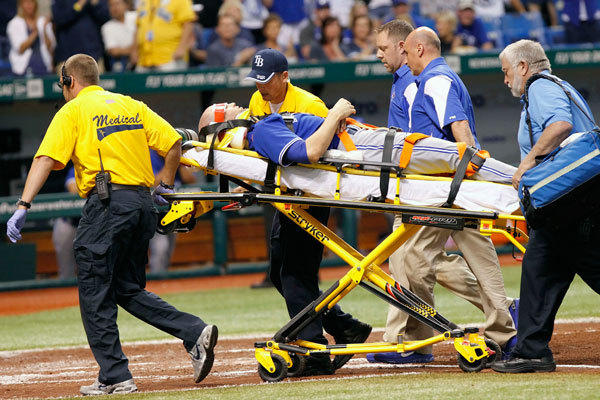 Toronto Blue Jays starting pitcher J.A. Happ (48) is carted off the field after Tampa Bay Rays center fielder Desmond Jennings (not pictured) hit him in the head by a line drive during the second inning against the Tampa Bay Rays at Tropicana.