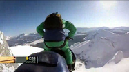 Rider on snowmobile flies off cliff to honor dead friend [Video]