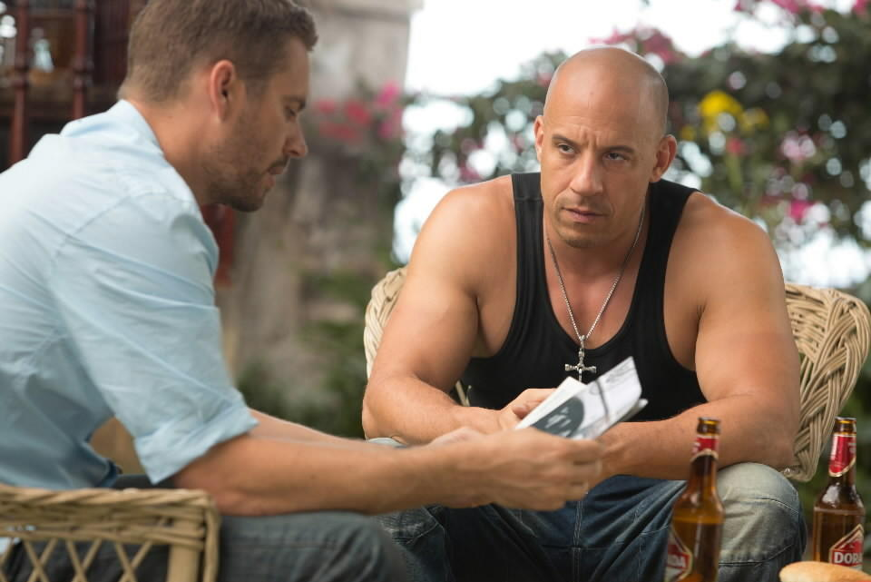 "<br><br>PG-13; 2:10 running time<br><br>""Fast & Furious 6,"" which surely maxed out Universal's tank-top budget for the year, and sustains its joyful, unpretentious ridiculousness so perfectly that I secretly hoped the ""6"" meant ""hours long,"" ends with a disclaimer, the sort of legalese that typically arrives at the tail end of the closing credits. To paraphrase: On the way out of this theater, should you get the urge to drive your tank into traffic across a towering bridge in Spain, or feel the need to race a Dodge Charger down a runway and bring down a military transport with harpoons, Universal Pictures will not be held responsible. Now here's the thing: I am being only partly facetious. -- Christopher Borrelli<br><br><a href=http://www.chicagotribune.com/entertainment/movies/sc-fast-furious-6-movie-review-20130523,0,3320477.column>Read the full ""Fast & Furious 6"" movie review</a>"