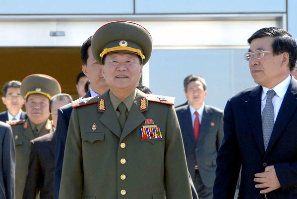 Choe Ryong Hae, center, director of the North Korean People's Army politburo, leaves the airport in Pyongyang to visit China.
