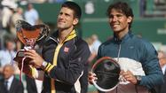 Defending French Open champion Rafael Nadal was drawn in the same half as world number one Novak Djokovic on Friday as the Spanish claycourt machine chases a record eighth title at Roland Garros.