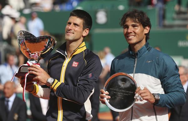 Novak Djokovic and Rafael Nadal with their trophies after their final match during day eight of the ATP Monte Carlo Masters on April 21.