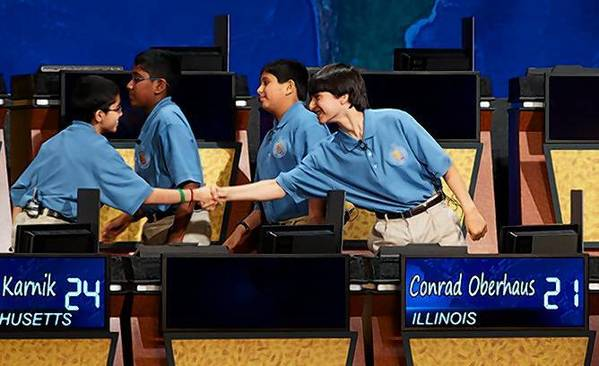 Conrad Oberhaus, a seventh grader from Lincolnshire, shakes hands with Sathwik Karnik of Massachusetts. Karnik beat Oberhaus 5 to 4 in the final round of the National Geographic Bee May 22.