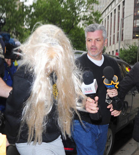 Actress Amanda Bynes departs Manhattan Central Booking after being arrested on May 23 2013 for alleged charges of reckless endangerment, tampering with evidence and criminal possession of marijuana at Manhattan Criminal Court on May 24, 2013 in New York City.