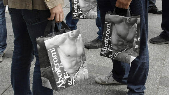 Shoppers hold Abercrombie & Fitch bags outside the Paris store in 2011.