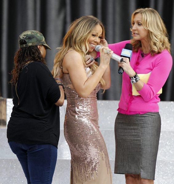 "Mariah Carey gets some help with her failing dress from ""Good Morning America"" host Lara Spencer and an assistant."