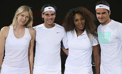 From left to right, Tennis greats, Maria Sharapova, Rafael Nadal, Serena Williams and Roger Federer greet the media before a charity game during an exhibition in Paris on May 23. The French Open starts on May 26.