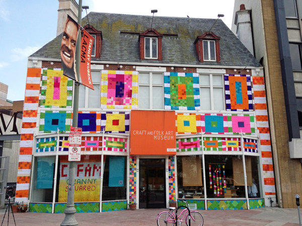 The facade of the Craft and Folk Art Museum in Los Angeles has been covered in crocheted granny squares.
