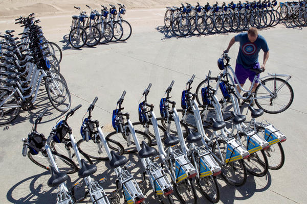 Christopher Czambel arranges bikes at North Avenue Beach for a private tour.