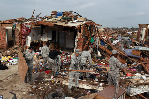 U.S. Air Force personnel help residents in Moore, Okla., sort through a tangle of debris after Monday's tornado.