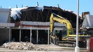 Bulldozers have arrived at the former Jewel Osco site in downtown Wheaton, demolishing the building that has been vacant for several years.