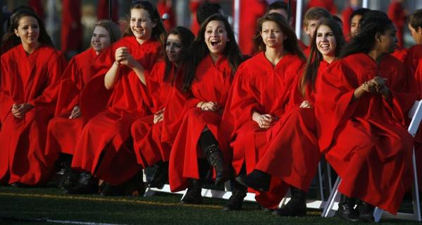 Students react during John Burroughs High School's commencement ceremony, which took place at the Memorial Field in Burbank.