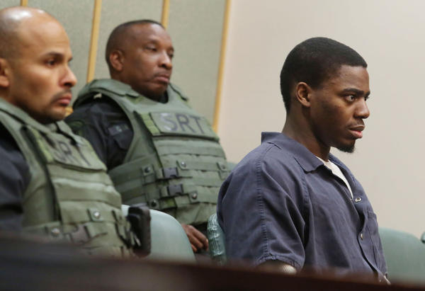 Under heavy security Bessman Okafor,right,attends a court hearing for his upcoming home invasion trial scheduled for June 3. Ocoee police say Okafor,28, shot three people while on Orange County's home-confinement program, two of whom were scheduled to testify against him at trial in his home-invasion case.