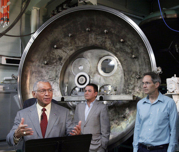 NASA Administrator Charles Bolden, left, is joined by Firouz Naderi, director for solar system exploration, and John Brophy, electric propulsion engineer, during Bolden's visit to the Jet Propulsion Laboratory in Pasadena on Thursday. NASA engineers are developing an ion engine for an asteroid capture mission later this decade.