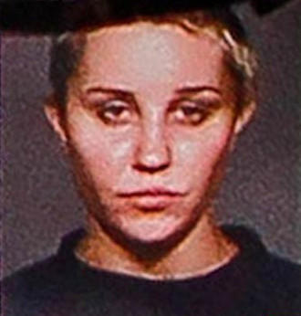 The troubled actress was made to remove her wig for a second booking photo related to her May 2013 arrest in New York. The new mug shot reveals a shaved head, minus some random strands of hair near her forehead.